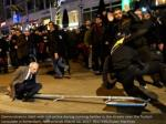 demonstrators conflict with uproar police amid