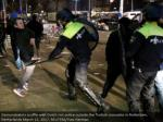 demonstrators fight with dutch uproar police