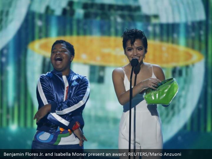 Benjamin Flores Jr. what's more, Isabella Moner show a honor. REUTERS/Mario Anzuoni