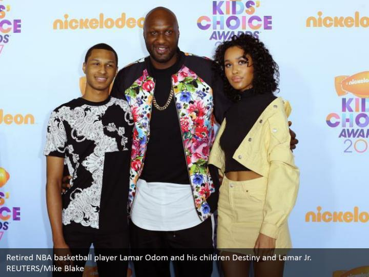 Retired NBA ball player Lamar Odom and his kids Destiny and Lamar Jr. REUTERS/Mike Blake