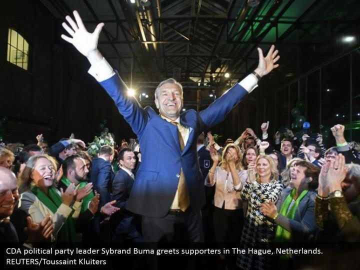 CDA political gathering pioneer Sybrand Buma welcomes supporters in The Hague, Netherlands. REUTERS/Toussaint Kluiters