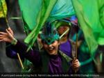 a member waves amid the st patrick s day parade