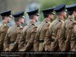 irish guards wear shamrock on their tops to check