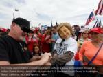 pro trump demonstrators pretend to put hand cuffs