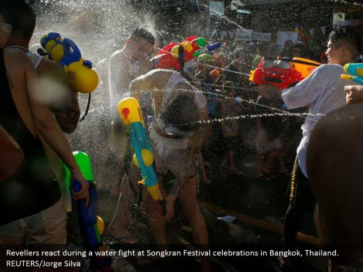 Revellers react during a water fight at Songkran Festival celebrations in Bangkok, Thailand. REUTERS/Jorge Silva