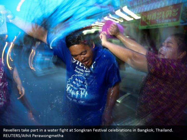 Revellers take part in a water fight at Songkran Festival celebrations in Bangkok, Thailand. REUTERS/Athit Perawongmetha