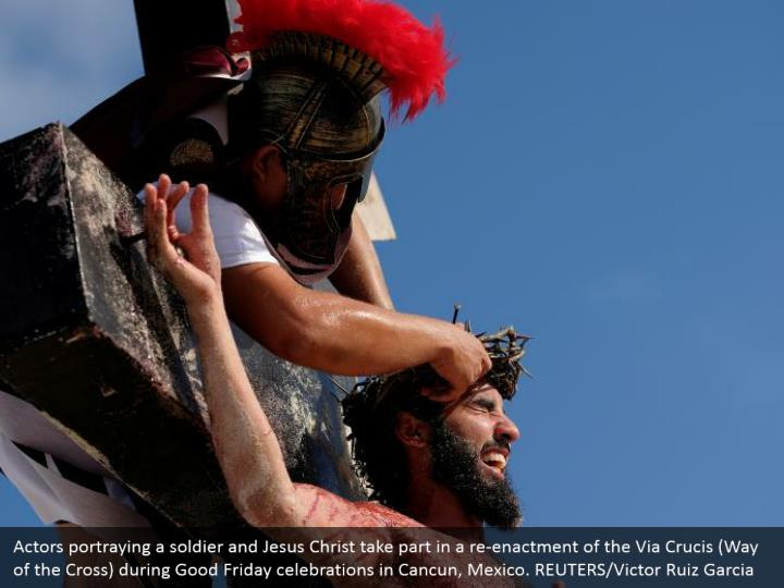Actors portraying a soldier and Jesus Christ take part in a re-enactment of the Via Crucis (Way of the Cross) during Good Friday celebrations in Cancun, Mexico. REUTERS/Victor Ruiz Garcia