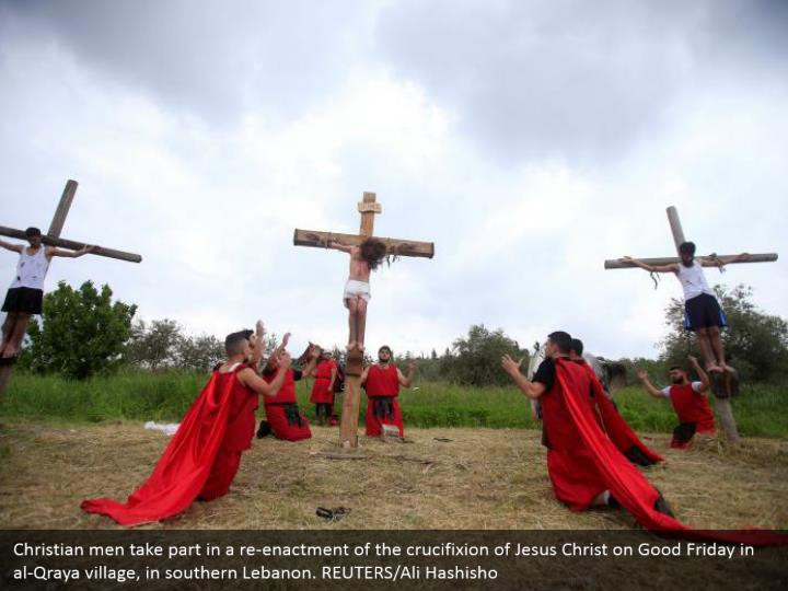 Christian men take part in a re-enactment of the crucifixion of Jesus Christ on Good Friday in al-Qraya village, in southern Lebanon. REUTERS/Ali Hashisho