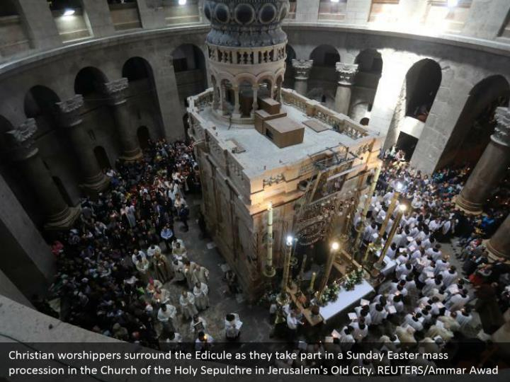 Christian worshippers surround the Edicule as they take part in a Sunday Easter mass procession in the Church of the Holy Sepulchre in Jerusalem's Old City. REUTERS/Ammar Awad