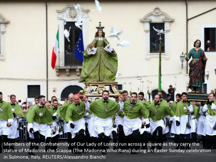 Members of the Confraternity of Our Lady of Loreto run across a square as they carry the statue of Madonna che Scappa (The Madonna Who Runs) during an Easter Sunday celebration in Sulmona, Italy. REUTERS/Alessandro Bianchi