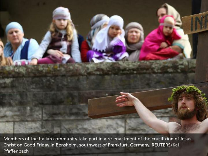 Members of the Italian community take part in a re-enactment of the crucifixion of Jesus Christ on Good Friday in Bensheim, southwest of Frankfurt, Germany. REUTERS/Kai Pfaffenbach