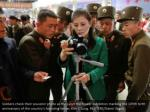 soldiers check their souvenir photo as they visit