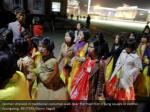 women dressed in traditional costumes walk near
