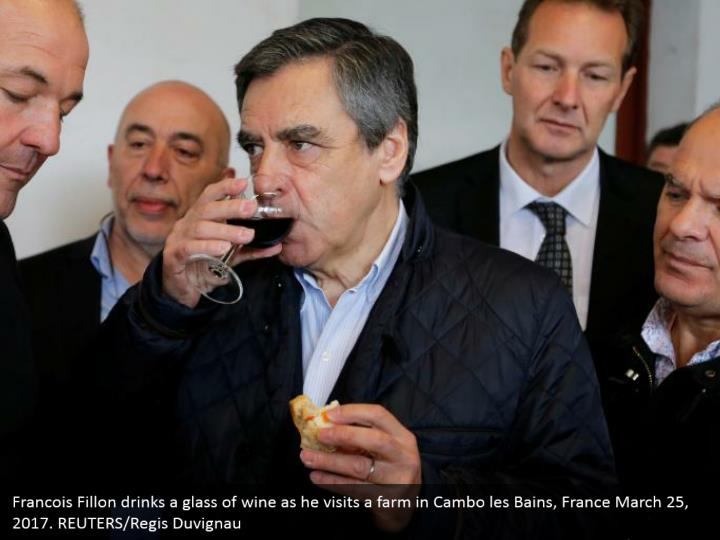 Francois Fillon drinks a glass of wine as he visits a farm in Cambo les Bains, France March 25, 2017. REUTERS/Regis Duvignau