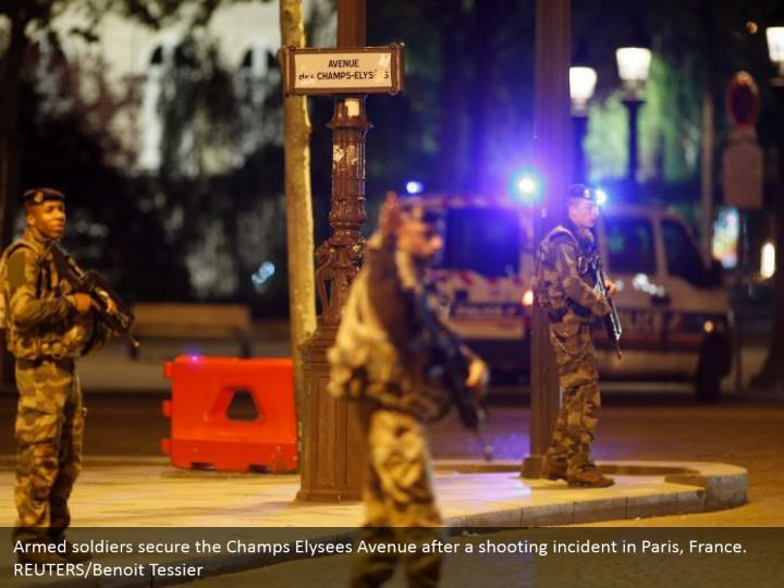 Armed soldiers secure the Champs Elysees Avenue after a shooting incident in Paris, France.  REUTERS/Benoit Tessier