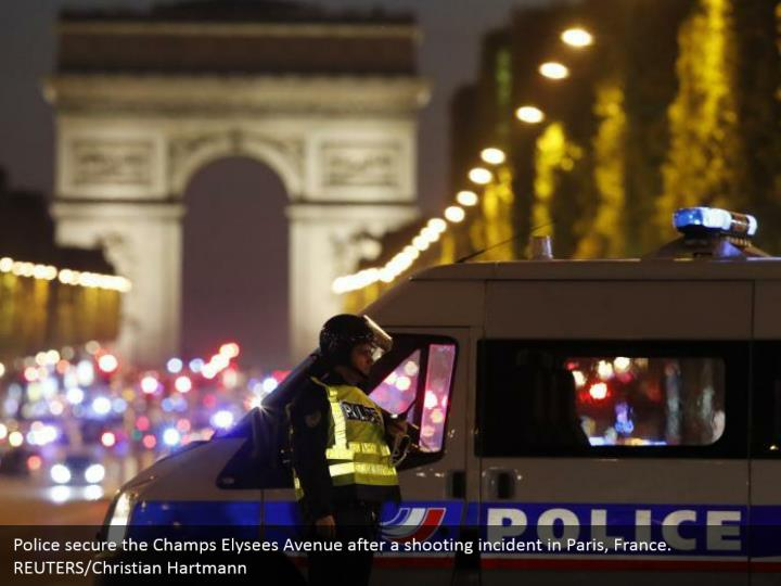 Police secure the Champs Elysees Avenue after a shooting incident in Paris, France.  REUTERS/Christian Hartmann