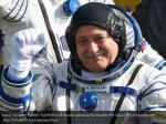 crew member fyodor yurchikhin of russia waves