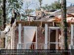 a homeowner takes stock of the damage to his home