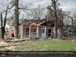 homeowners clean up debris after a tornado