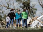 homeowners take stock of damage to their home