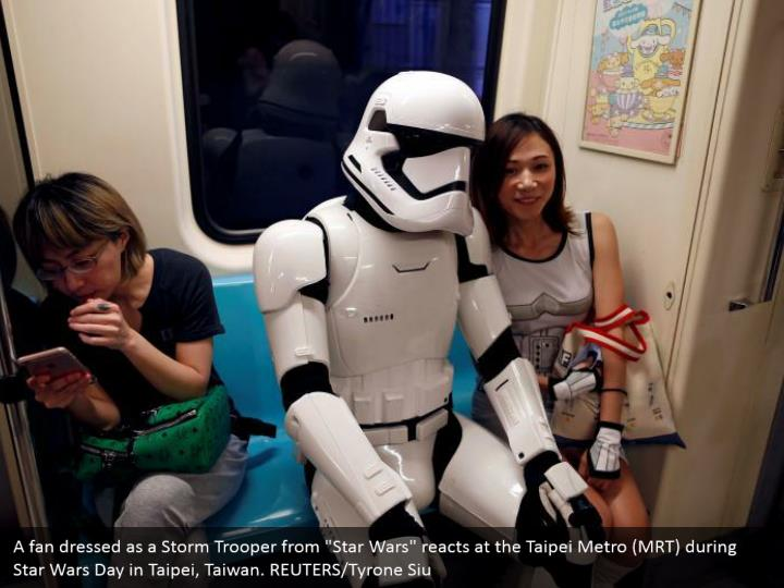 """A fan dressed as a Storm Trooper from """"Star Wars"""" reacts at the Taipei Metro (MRT) during Star Wars Day in Taipei, Taiwan. REUTERS/Tyrone Siu"""