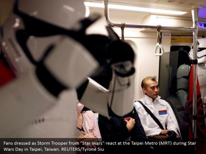 """Fans dressed as Storm Trooper from """"Star Wars"""" react at the Taipei Metro (MRT) during Star Wars Day in Taipei, Taiwan. REUTERS/Tyrone Siu"""