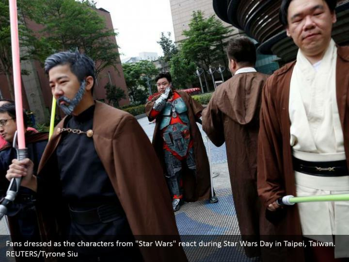 """Fans dressed as the characters from """"Star Wars"""" react during Star Wars Day in Taipei, Taiwan. REUTERS/Tyrone Siu"""