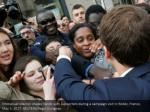 emmanuel macron shakes hands with supporters