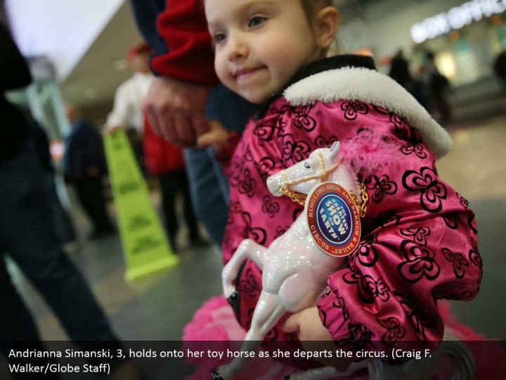 Andrianna Simanski, 3, holds onto her toy horse as she departs the circus. (Craig F. Walker/Globe Staff)