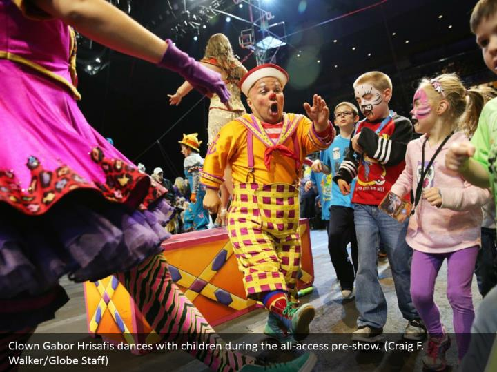 Clown Gabor Hrisafis dances with children during the all-access pre-show. (Craig F. Walker/Globe Staff)
