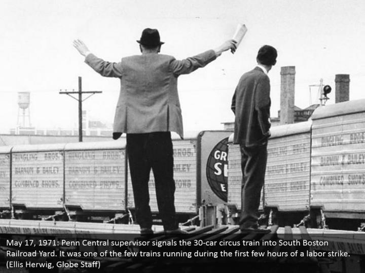 May 17, 1971: Penn Central supervisor signals the 30-car circus train into South Boston Railroad Yard. It was one of the few trains running during the first few hours of a labor strike. (Ellis Herwig, Globe Staff)