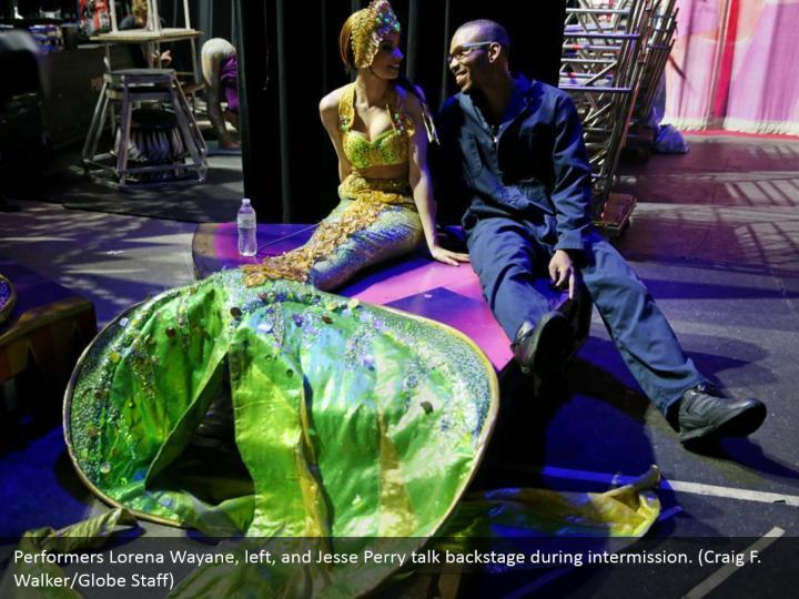 Performers Lorena Wayane, left, and Jesse Perry talk backstage during intermission. (Craig F. Walker/Globe Staff)