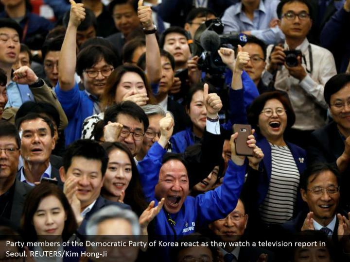 Party members of the Democratic Party of Korea react as they watch a television report in Seoul. REUTERS/Kim Hong-Ji