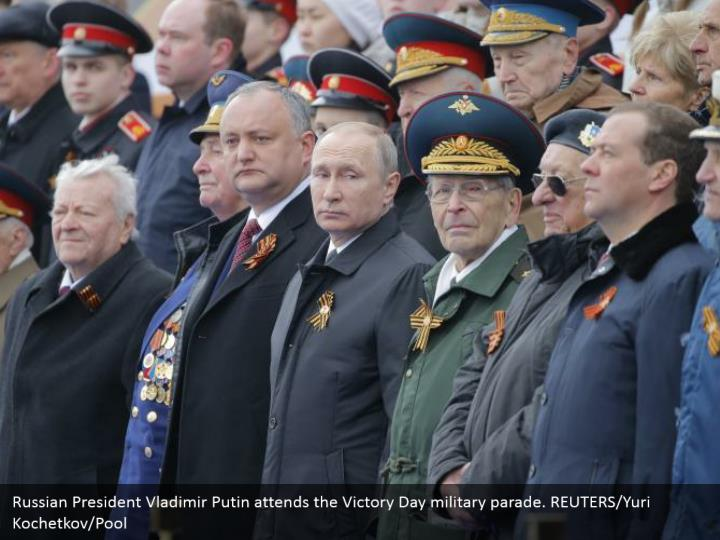 Russian President Vladimir Putin attends the Victory Day military parade. REUTERS/Yuri Kochetkov/Pool