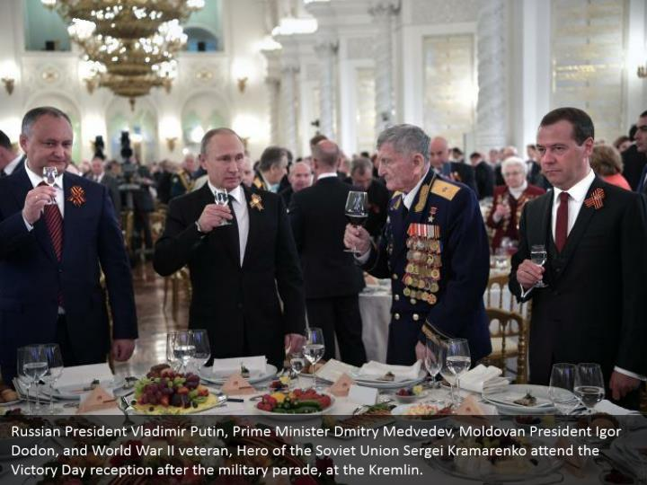Russian President Vladimir Putin, Prime Minister Dmitry Medvedev, Moldovan President Igor Dodon, and World War II veteran, Hero of the Soviet Union Sergei Kramarenko attend the Victory Day reception after the military parade, at the Kremlin.
