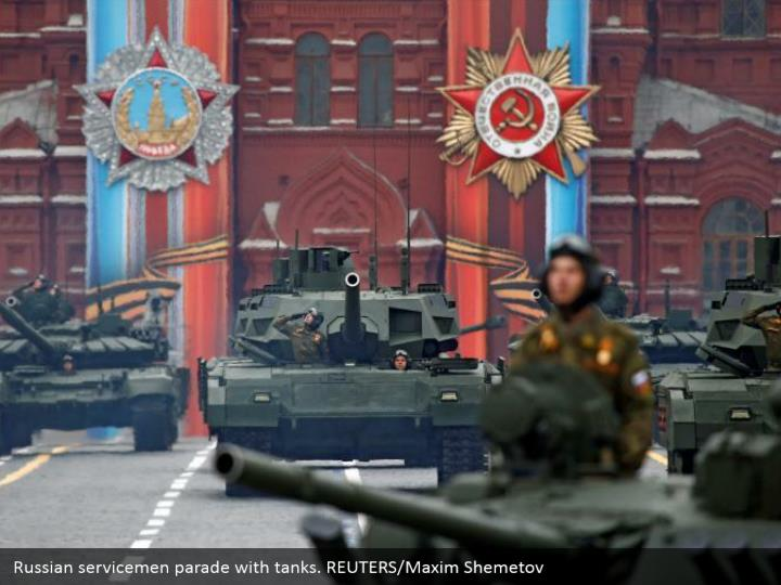 Russian servicemen parade with tanks. REUTERS/Maxim Shemetov