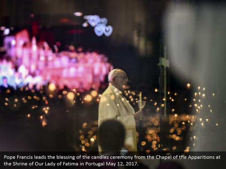 Pope francis leads the blessing of the candles