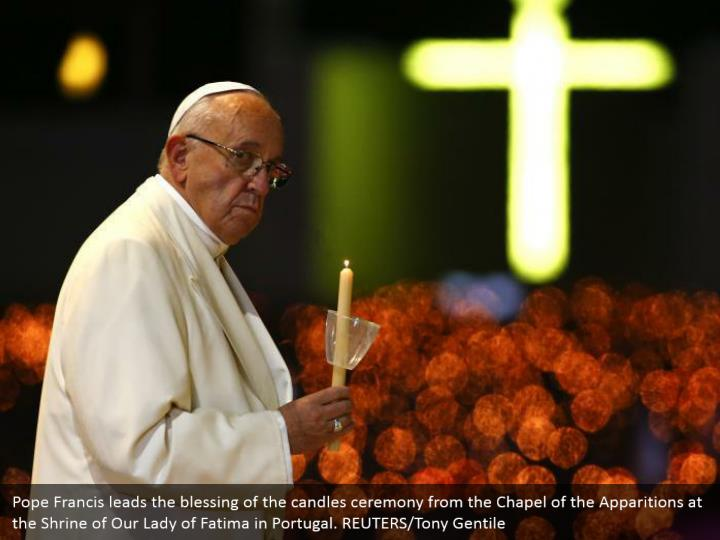 Pope Francis leads the blessing of the candles ceremony from the Chapel of the Apparitions at the Shrine of Our Lady of Fatima in Portugal. REUTERS/Tony Gentile