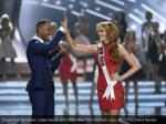show host terrence j slaps hands with miss