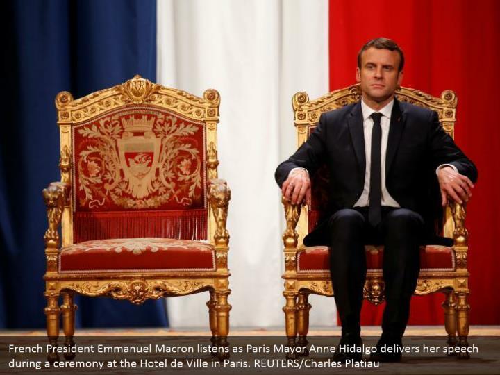 French president emmanuel macron listens as paris
