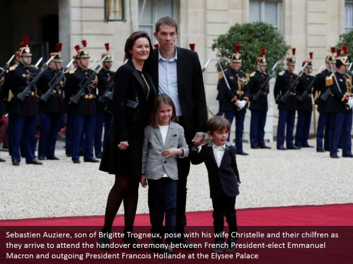Sebastien Auziere, son of Brigitte Trogneux, pose with his wife Christelle and their chilfren as they arrive to attend the handover ceremony between French President-elect Emmanuel Macron and outgoing President Francois Hollande at the Elysee Palace