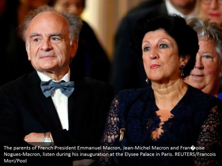 The parents of French President Emmanuel Macron, Jean-Michel Macron and Fran�oise Nogues-Macron, listen during his inauguration at the Elysee Palace in Paris. REUTERS/Francois Mori/Pool