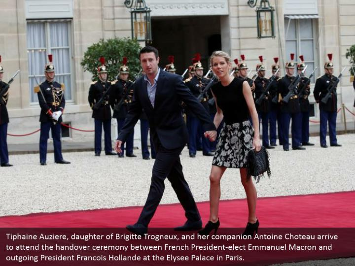 Tiphaine Auziere, daughter of Brigitte Trogneux, and her companion Antoine Choteau arrive to attend the handover ceremony between French President-elect Emmanuel Macron and outgoing President Francois Hollande at the Elysee Palace in Paris.