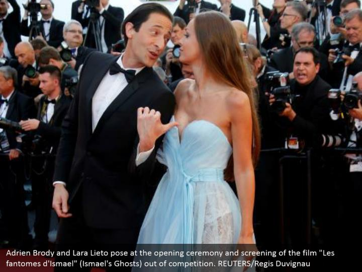 "Adrien Brody and Lara Lieto pose at the opening ceremony and screening of the film ""Les fantomes d'Ismael"" (Ismael's Ghosts) out of competition. REUTERS/Regis Duvignau"