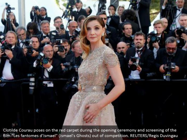"Clotilde Courau poses on the red carpet during the opening ceremony and screening of the film ""Les fantomes d'Ismael"" (Ismael's Ghosts) out of competition. REUTERS/Regis Duvingau"