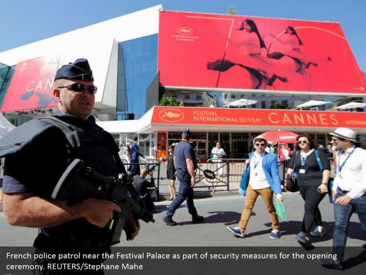 French police patrol near the Festival Palace as part of security measures for the opening ceremony. REUTERS/Stephane Mahe