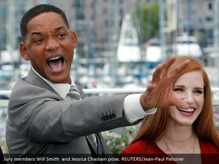 Jury members Will Smith  and Jessica Chastain pose. REUTERS/Jean-Paul Pelissier