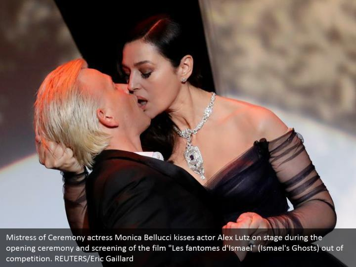 "Mistress of Ceremony actress Monica Bellucci kisses actor Alex Lutz on stage during the opening ceremony and screening of the film ""Les fantomes d'Ismael"" (Ismael's Ghosts) out of competition. REUTERS/Eric Gaillard"