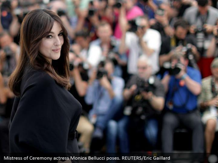 Mistress of Ceremony actress Monica Bellucci poses. REUTERS/Eric Gaillard