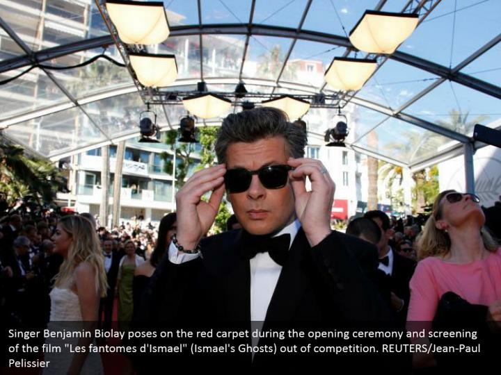 "Singer Benjamin Biolay poses on the red carpet during the opening ceremony and screening of the film ""Les fantomes d'Ismael"" (Ismael's Ghosts) out of competition. REUTERS/Jean-Paul Pelissier"